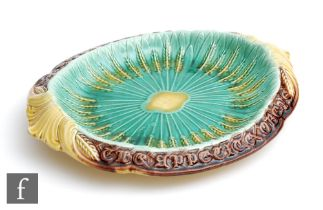 A late 19th Century majolica shaped bread plate with the motto 'Where reason rules the appetite