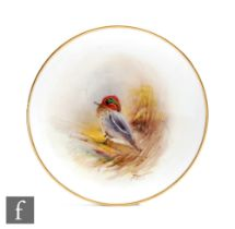 A small hand painted Royal Worcester pin dish decorated with a hand painted teal, titled verso,