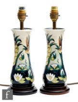 AMENDED DESCRIPTION A pair of Moorcroft Pottery table lamps decorated in the Lamia pattern