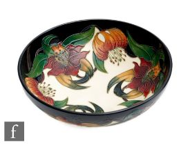 A large Moorcroft Pottery bowl decorated in the Anna Lily pattern designed by Nicola Slaney,