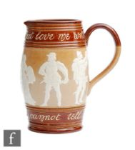 An early 20th Century Doulton Lambeth salt glazed stoneware motto jug with relief moulded figures