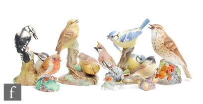 Seven assorted Royal Worcester models of birds comprising Blue Tits 3375, Thrush 3234, Waxwing 3648,
