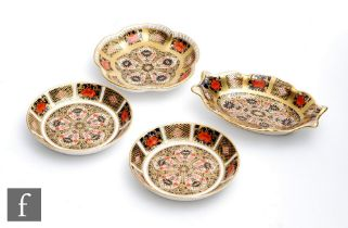 Four Royal Crown Derby pin dishes of varying form decorated in the Imari 1128 pattern, all with