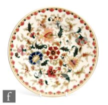 An early 20th Century Zsolnay Pecs plate with Persian decoration, impressed and printed mark,