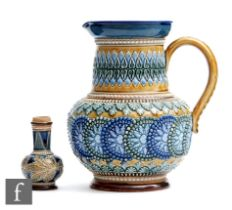 A late 19th Century Doulton Lambeth stoneware jug decorated with applied raised repeat patterns in