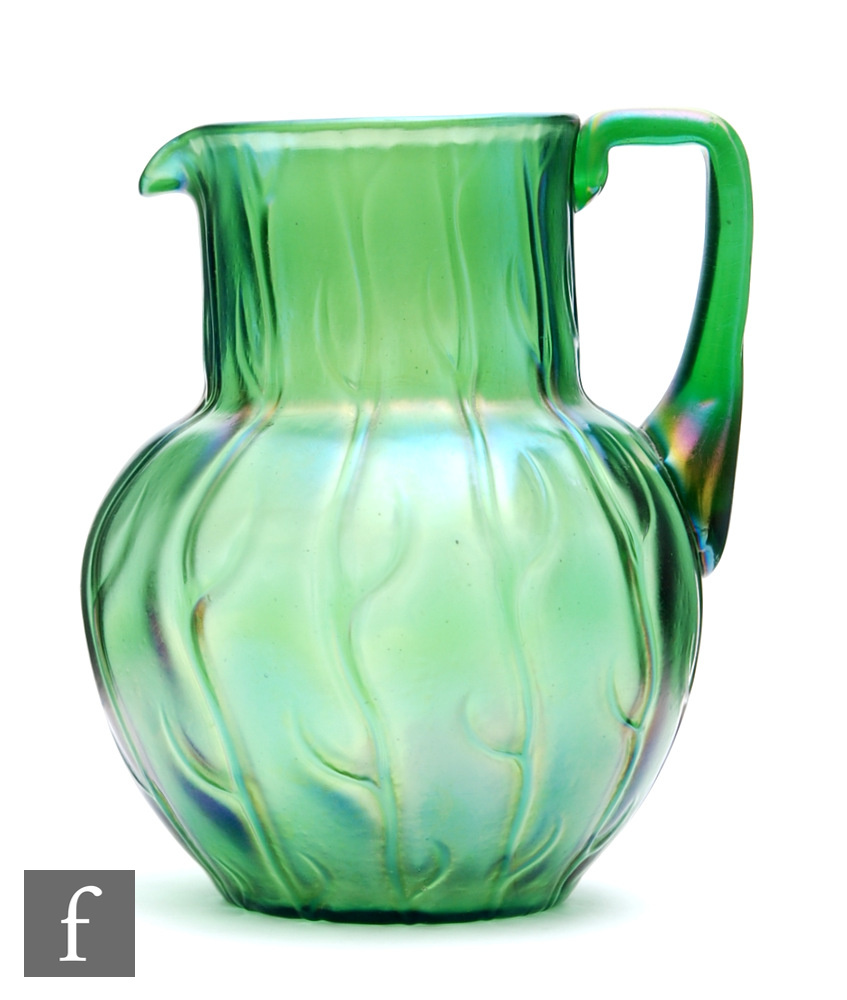 Loetz - An early 20th Century water jug in the Neptune pattern, of spherical form with a collar neck