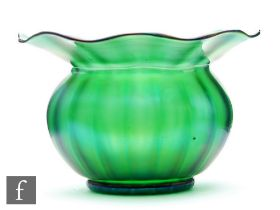 Loetz - A large early 20th Century glass bowl of fluted ovoid form with an everted wide flat rim