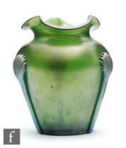 Kralik - An early 20th Century vase of shouldered ovoid form with a tri-form rim, decorated in the