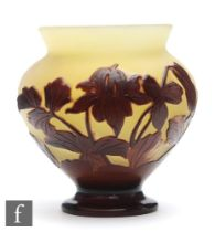 Galle - An early 20th Century French cameo glass vase of baluster form with everted rim, cased in