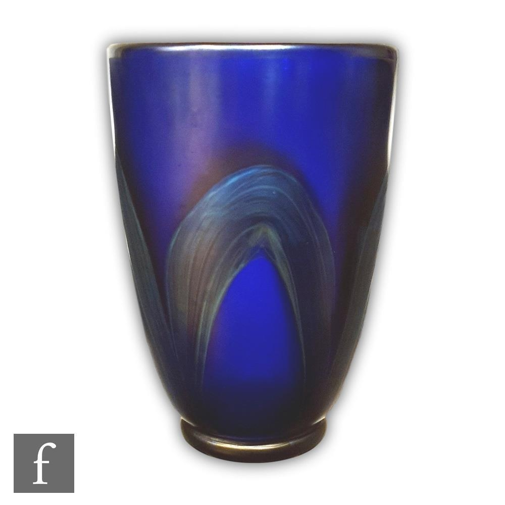 Loetz - An early 20th Century vase, circa 1905, of footed sleeve form, decorated with four petrol