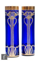 Unknown - Bohemian - A pair of continental Art Nouveau glass vases, each of sleeve form, with gilded