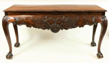 A good quality 19th Century Irish mahogany Side Table, the plain top with gadroon edge over a shaped
