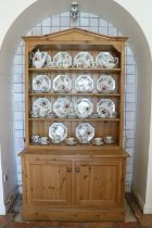 A good quality figured pine Dresser, the angled cornice over a four shelf open top, on a base with