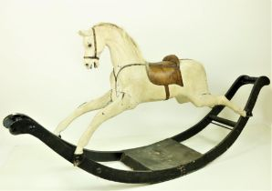 """A good old Edwardian black and white paintedwooden Rocking Horse, with leather saddle, 211cms (83"""")"""