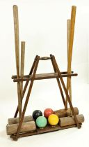 The 'Ilsborne' Croquet Carrier Stand, made by F.H. Ayres of London, with four mallets and four