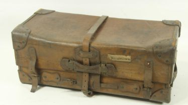 A very heavy late 19th Century leather Travelling Trunk, with reinforced corners and multiple straps