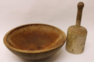 """A large wooden Bowl, 15"""" (39cms), and a turned Wooden Pounder, 13 1/2"""" (34cms). (2)"""