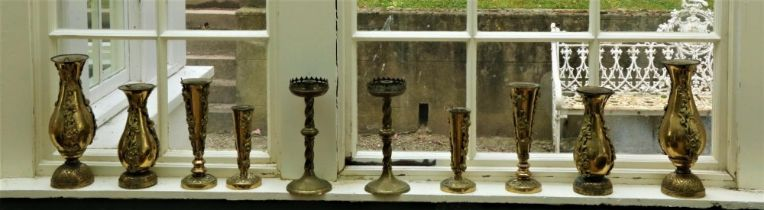 Brassware: A collection of late 19th Century ornate brass Vases, of variant shapes and design,