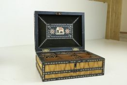 An attractive early 19th Century quill and ivory inlaid Curiosity Box, the hinged top opening to