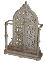 A heavy Victorian cast iron Stick and Umbrella Stand, probably Coalbrookdale, the arch back with