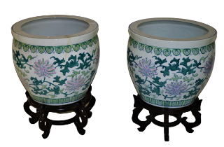 A pair of large modern Chinese Fish Bowls, decorated with stylized flowers on hardwood stands,
