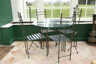 A modern heavy wrought iron Patio Suite, consisting of circular table with glass top, set of 4