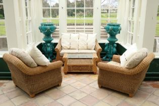 An attractive 8 piece cane workConservatory Suite, consisting of a two seater settee, two