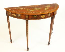 A George III mahogany demi-lune Side Table, profusely decorated with a centre urn issuing garlands