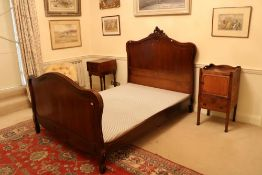 A French 4' walnut Bedstead, the panelled headboard with a leaf crest and conforming footboard,