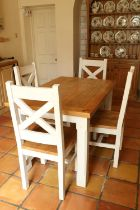 An oak and painted Kitchen Suite, comprising four heavy bracket type Chairs with X framed open