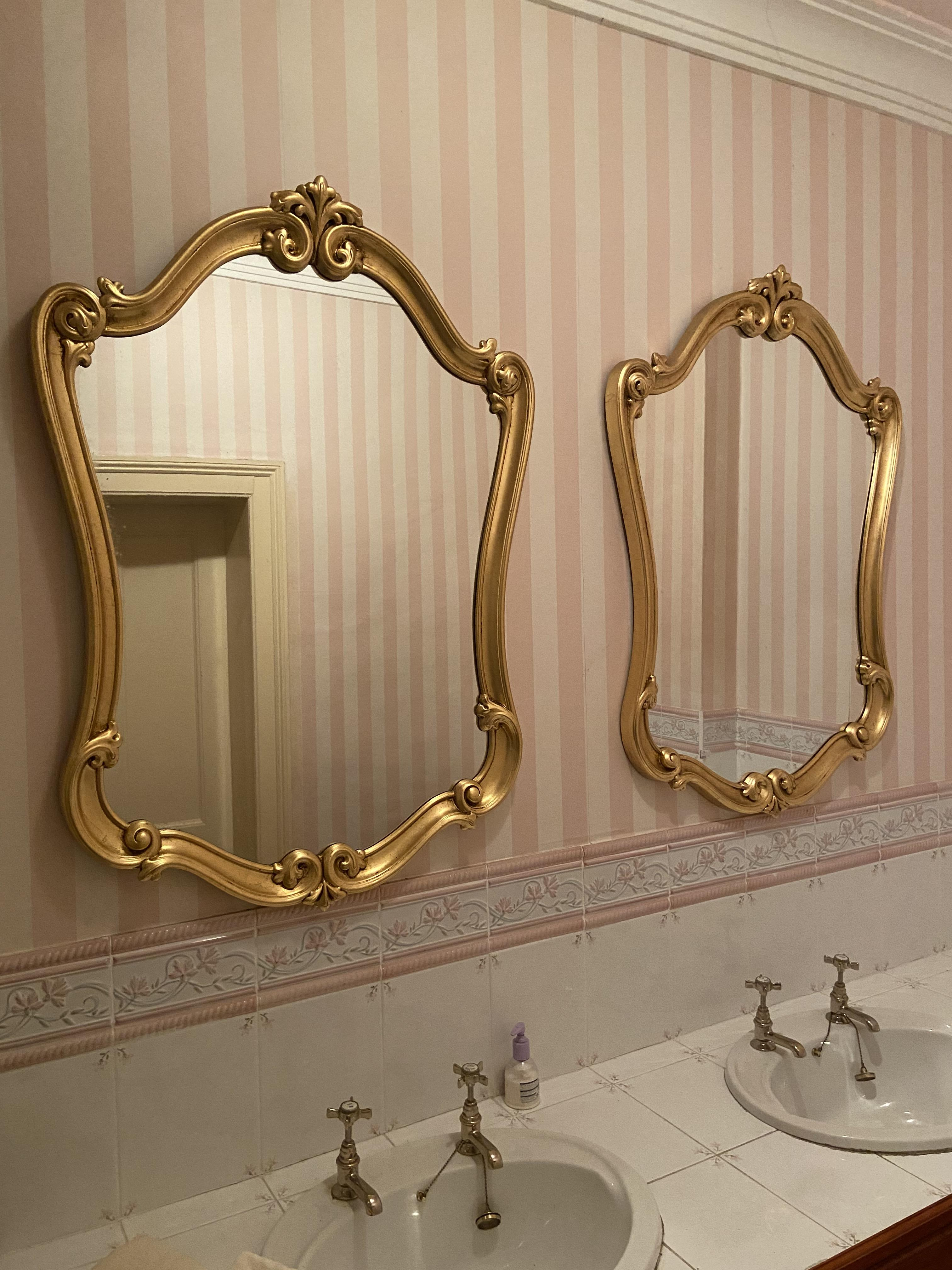 An attractive pair of gilt cartouche shaped Wall Mirrors, in scroll work frames, 43'' x 31'' (109cms