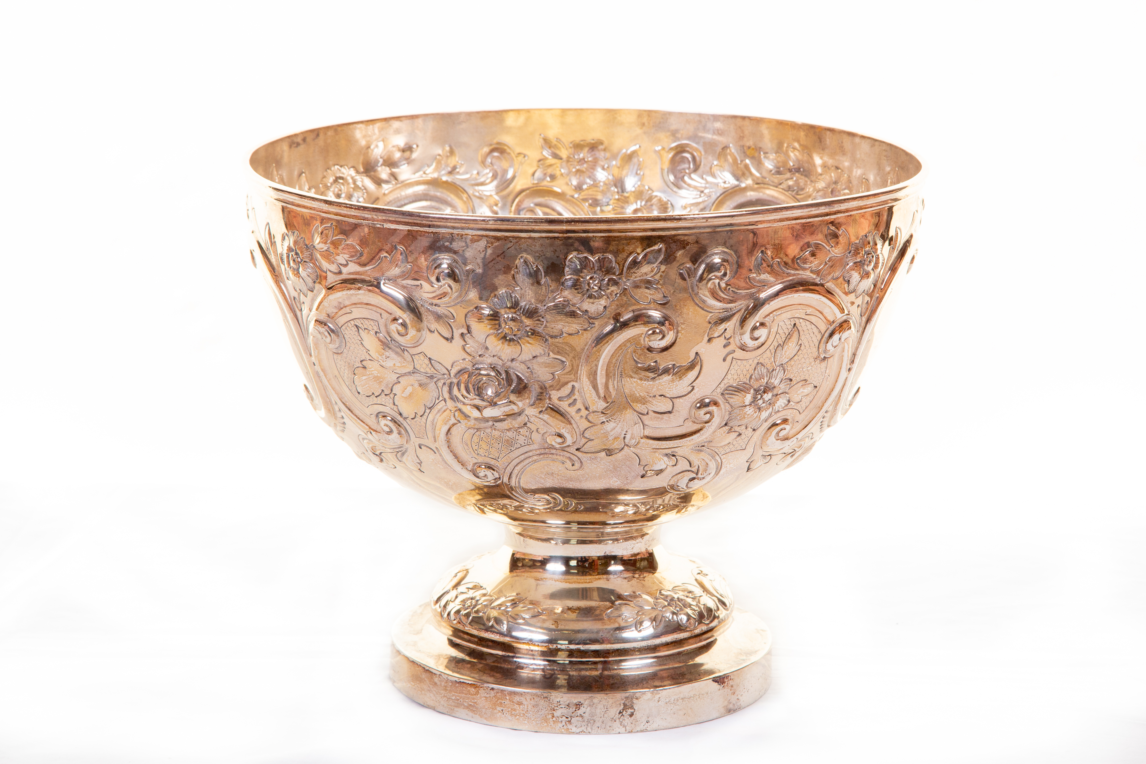 A large embossed Victorian silver Punch Bowl, London 1887, by Messrs Barnard, chased with scrolls