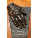 "Orla de Bri, Irish A bronze Model of a Man's hand mounted on shaped Valentia slate, inscribed ""To"