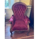 A Victorian style mahogany Armchair, with button back over a padded seat and padded arm, covered