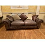 A large four seater hide Club Settee, with double cushion settee and cushion back, raised on bun
