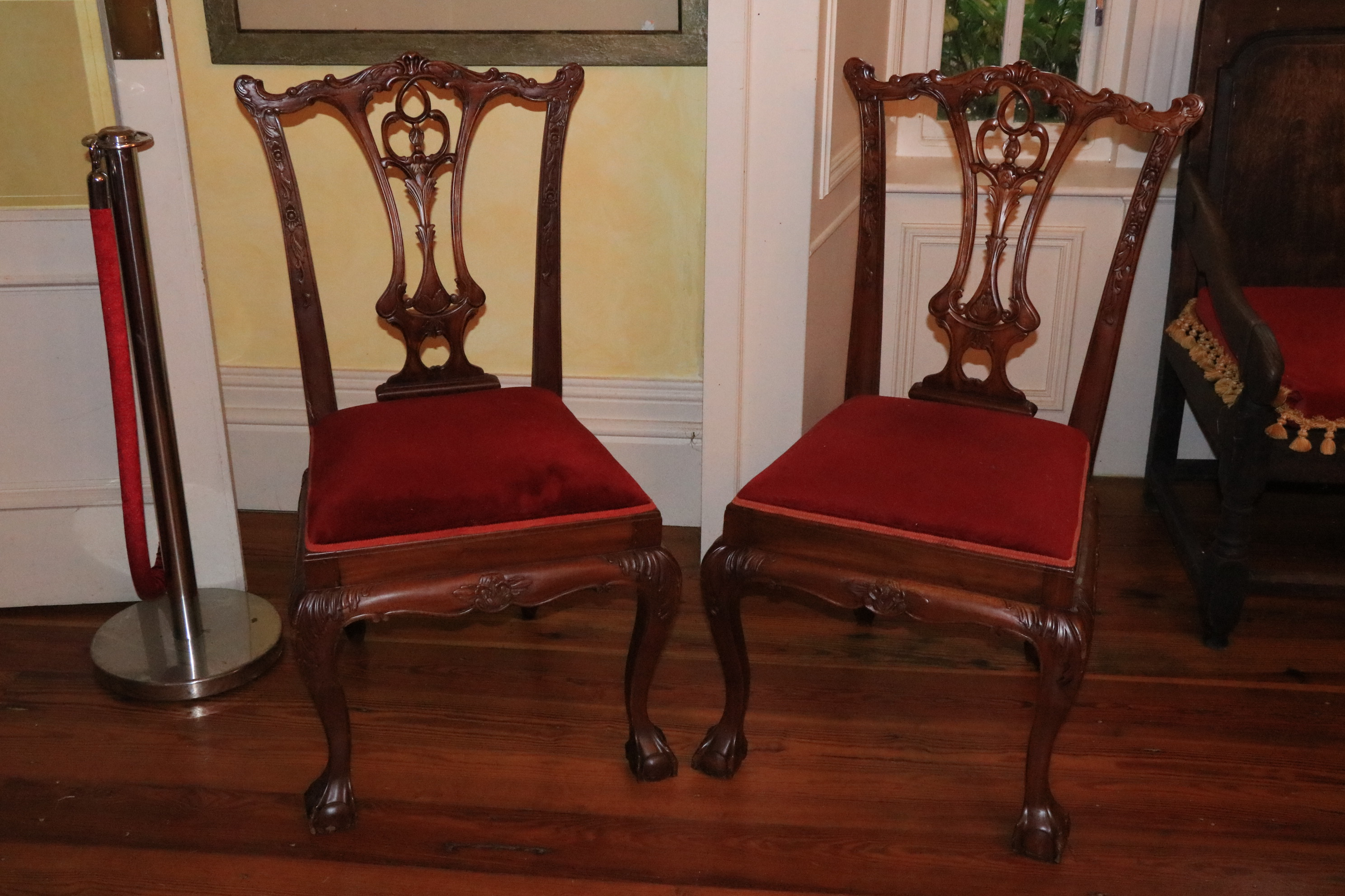 A set of 8 Chippendale style mahogany Dining Chairs, each with pierced vase shaped splat on front