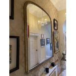 A large Victorian gilt gesso Mirror, with arched plate in moulded frame, 72'' x 65'' (183cms x