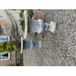 A set of 4 heavy cast iron Garden Urns, each with egg and dart moulded folded rim and ribbed body on