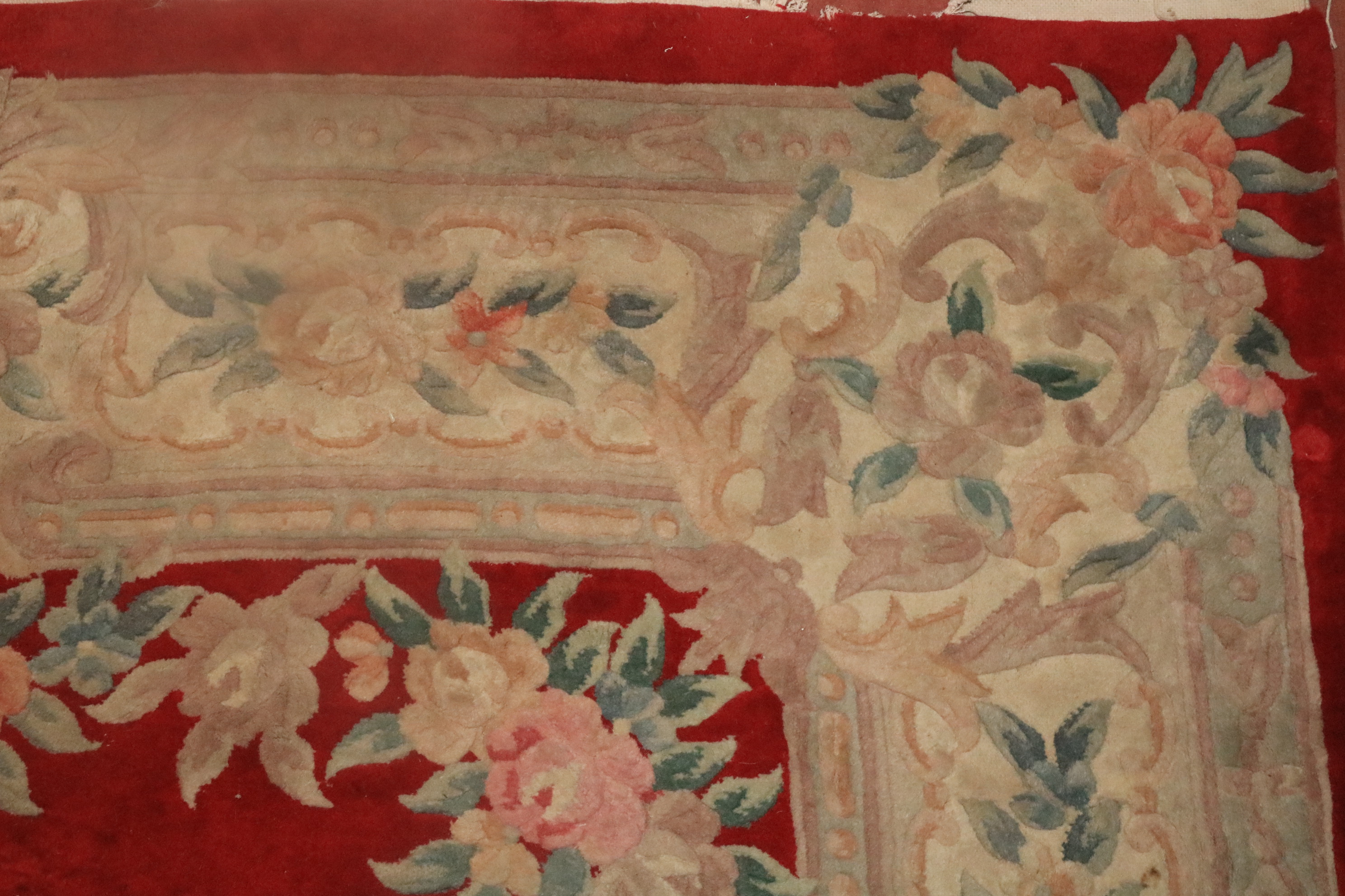 A heavy Chinese Rug, the centre red ground surrounded by a large floral border and similar decorated - Image 3 of 3