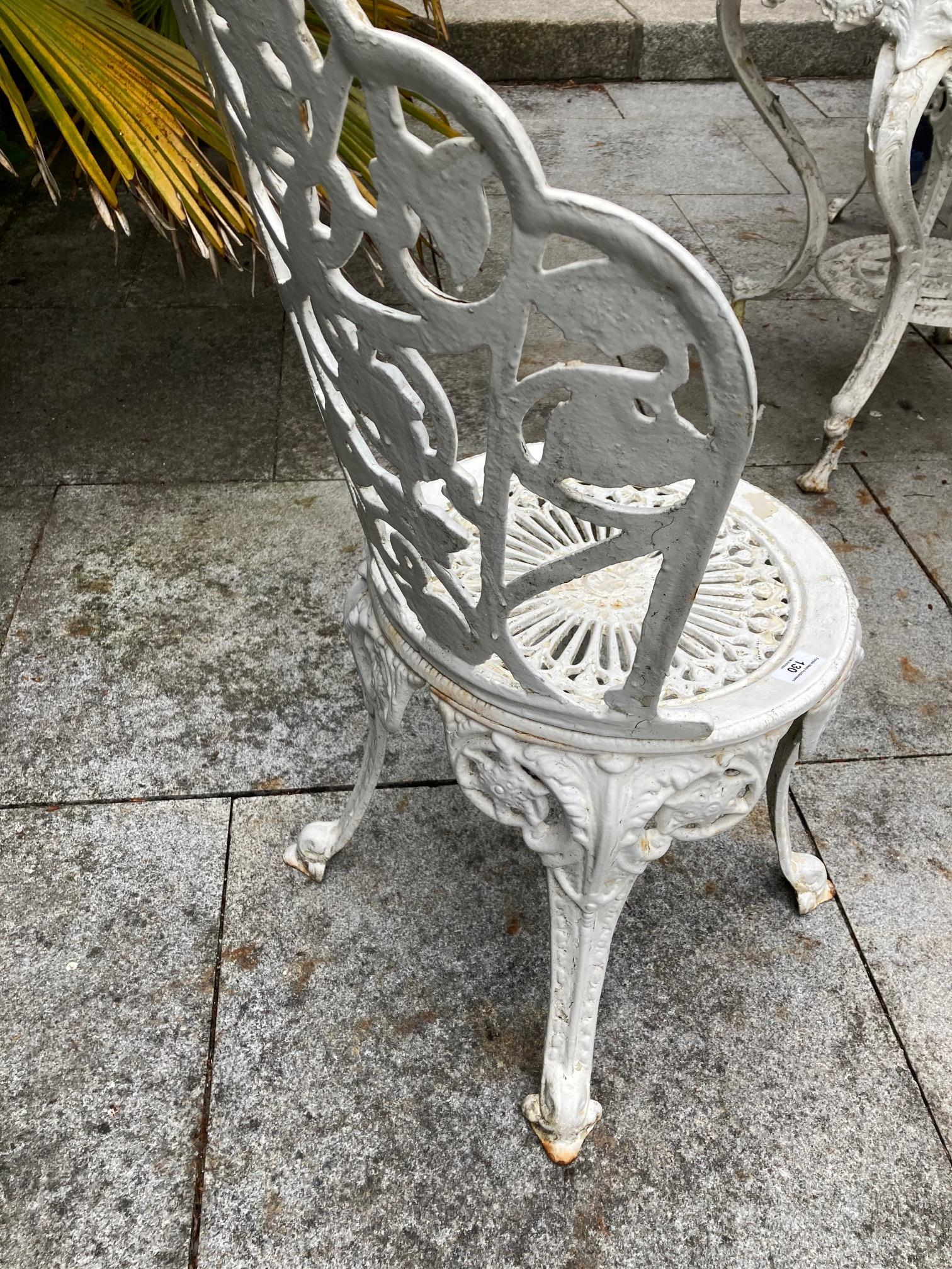 A four piece cast metal Patio Set, comprising a heavy circular table with open work top on four - Image 4 of 6