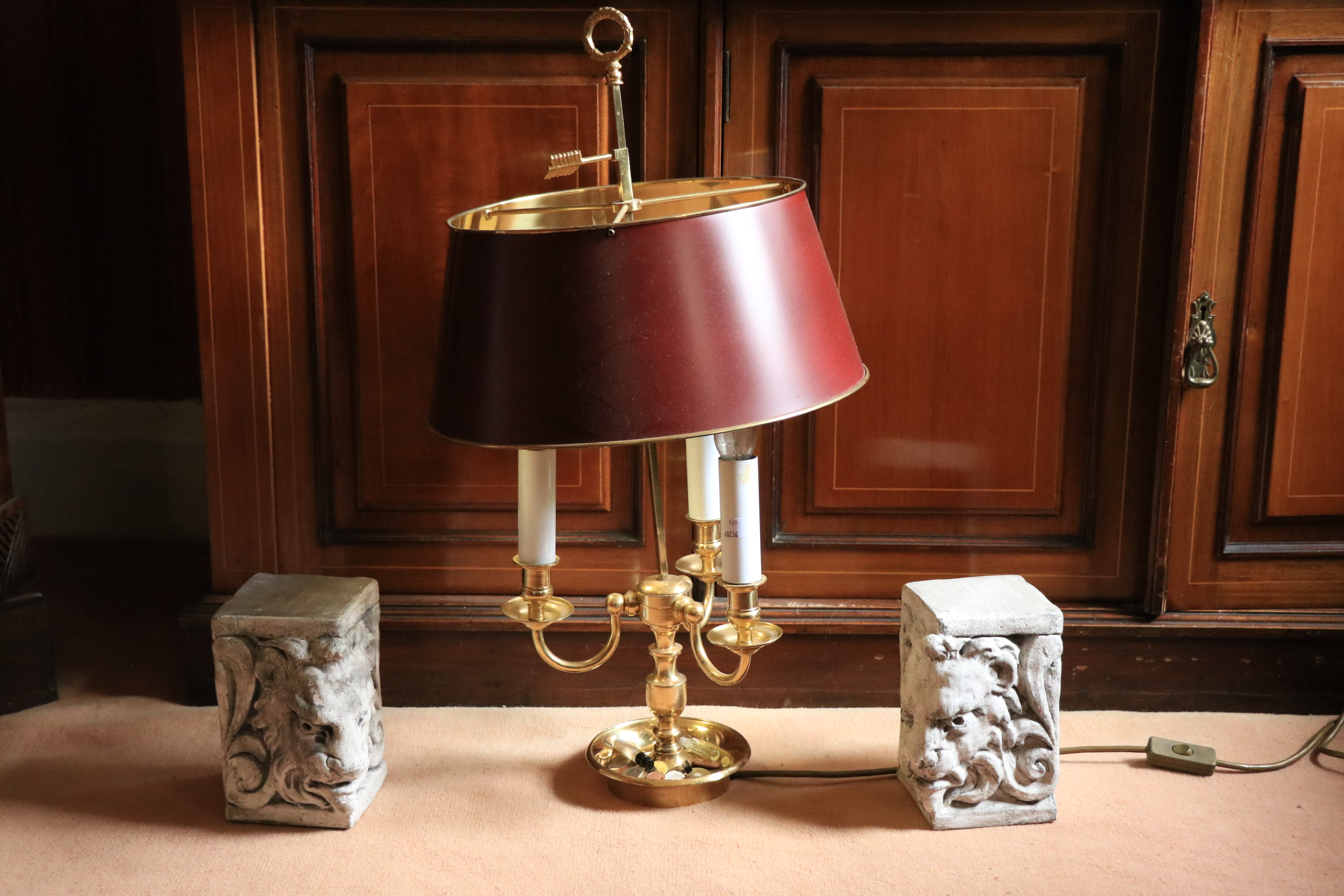 A brass three branch Desk Lamp, with metal shade on circular base, 27'' (68cms); together with a