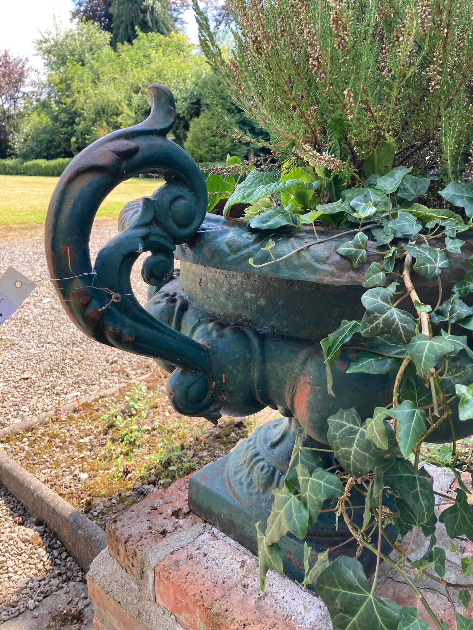 A pair of heavy green painted cast iron Garden Urns, each with two leaf scroll handles and half - Image 6 of 7