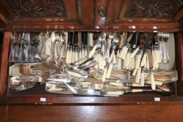 A large collection of various Newbridge Cutlery, including faux bone handled knives, plated forks,
