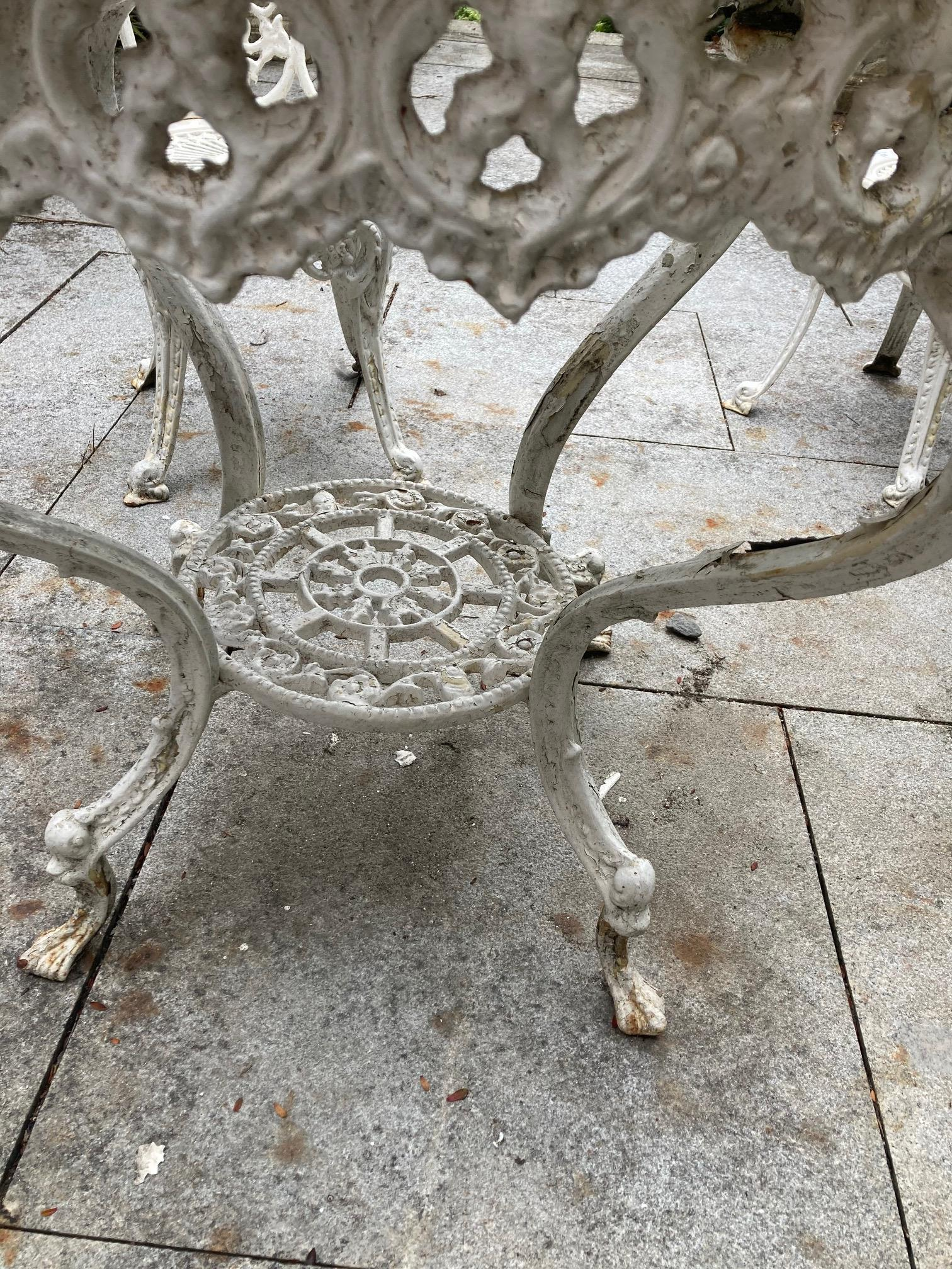 A four piece cast metal Patio Set, comprising a heavy circular table with open work top on four - Image 2 of 6