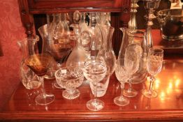 Two similar Waterford crystal John Rocha Wine Carafes, a glass Claret Jug and stopper, a plain glass