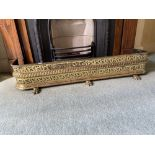A 19th Century pierced brass Fender, with roped centre back on three front paw feet, 46'' (