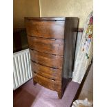 An Arts & Crafts bow fronted five drawer Chest, on square sabre legs, 47'' x 24'' (119cms x