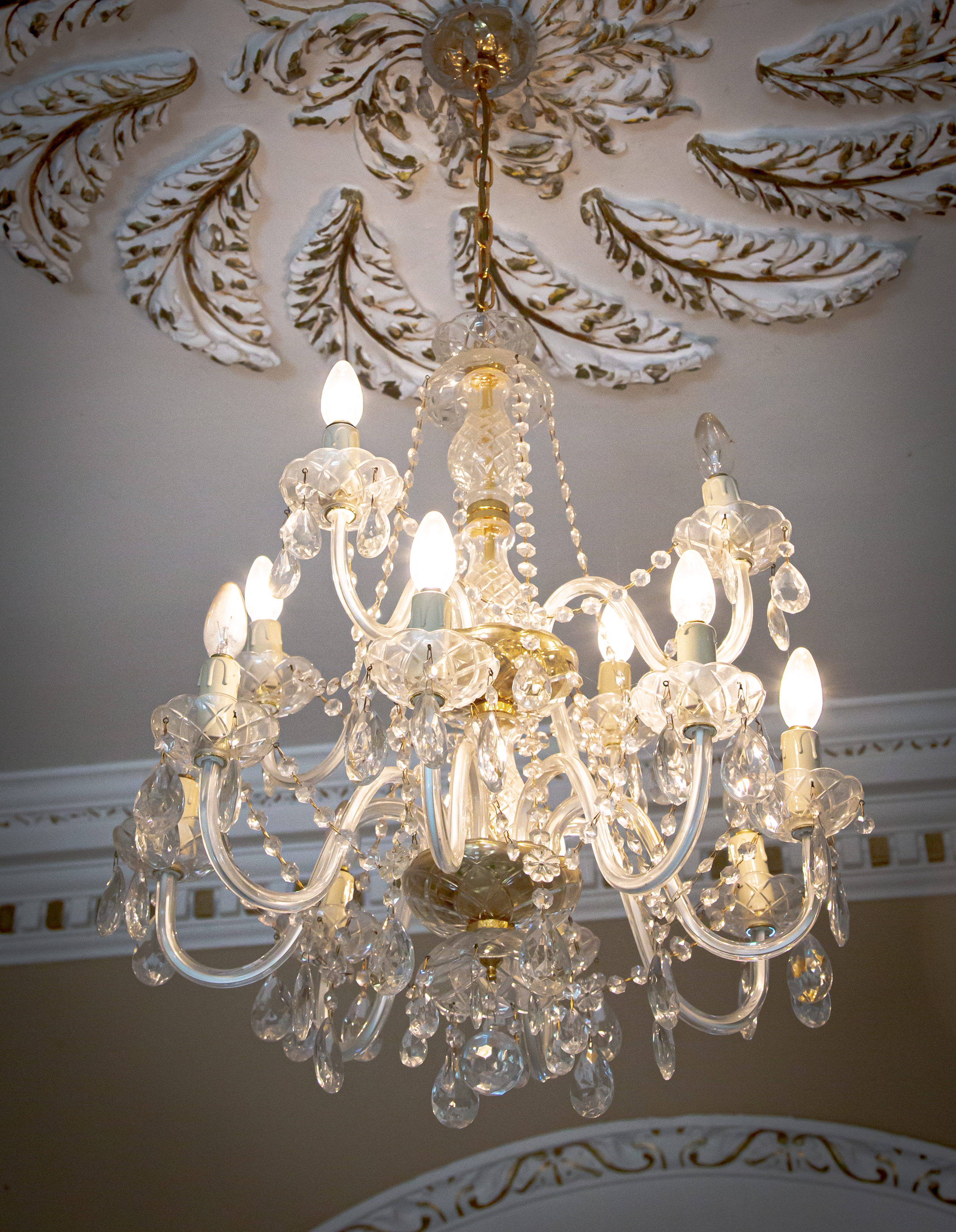 A superb crystal Chandelier, with 18 arms on three levels (3, 6 & 9) with festoons of buttons and