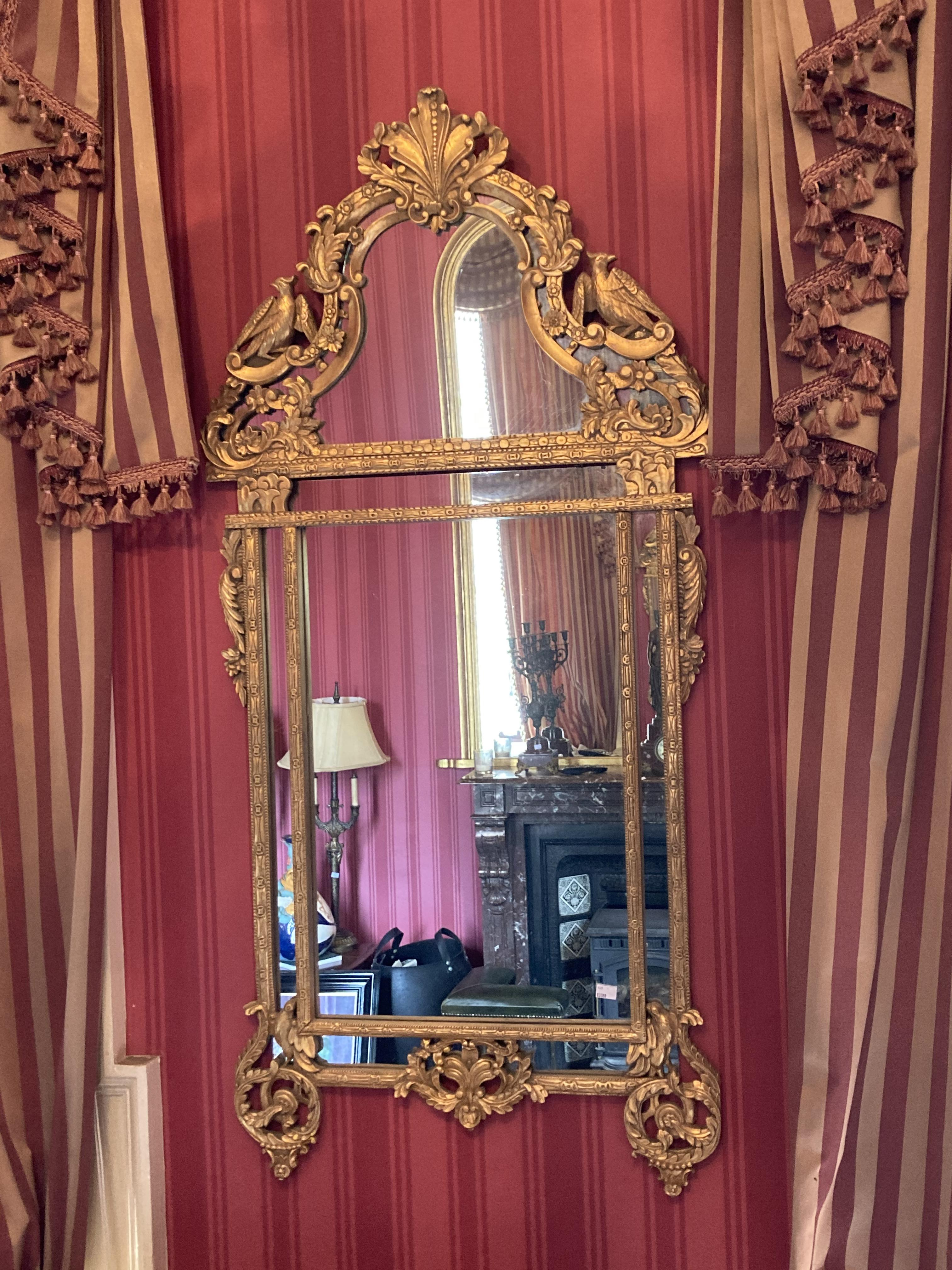 A Georgian style gilt Pier mirror, with arched top, shell decoration and Ho Ho birds, with leaf