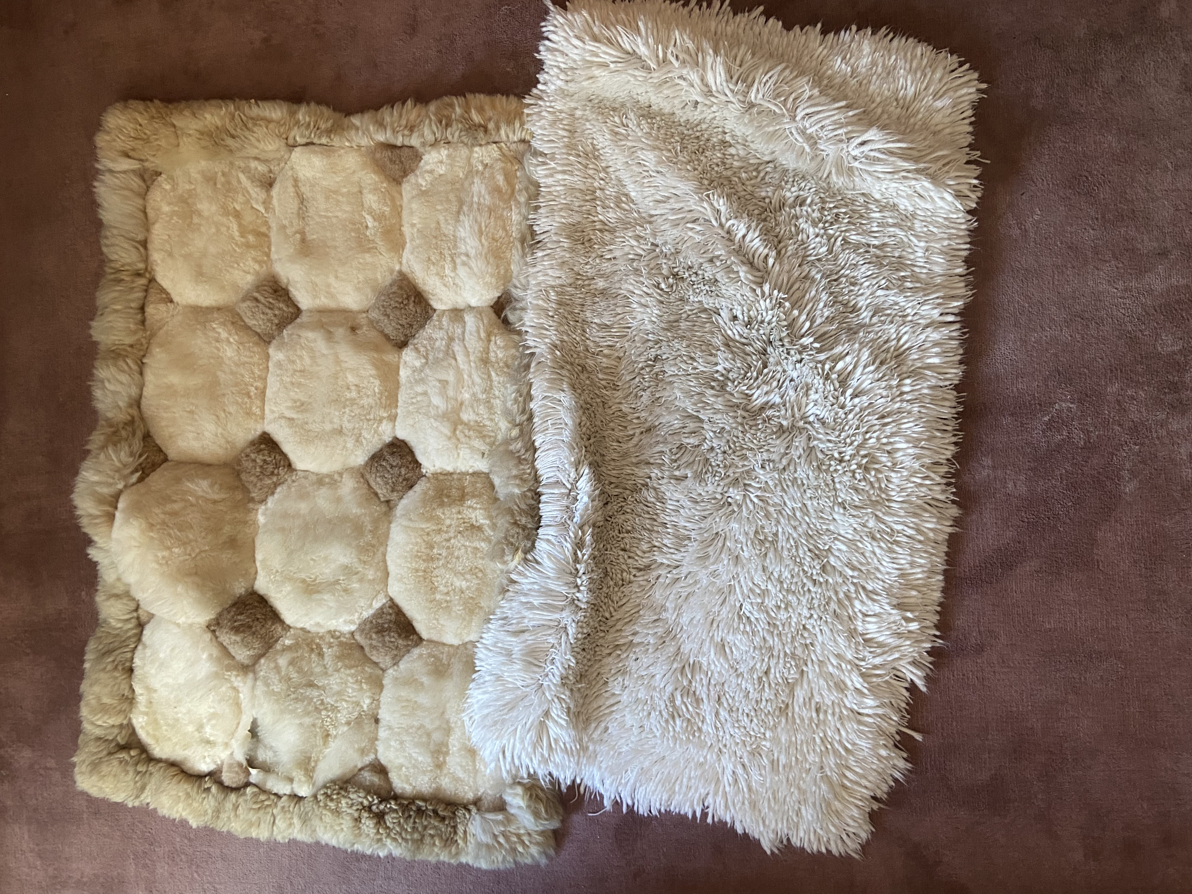 Three faux sheep wool Rugs, and two similar Cushions and a colourful floral Print. (5)